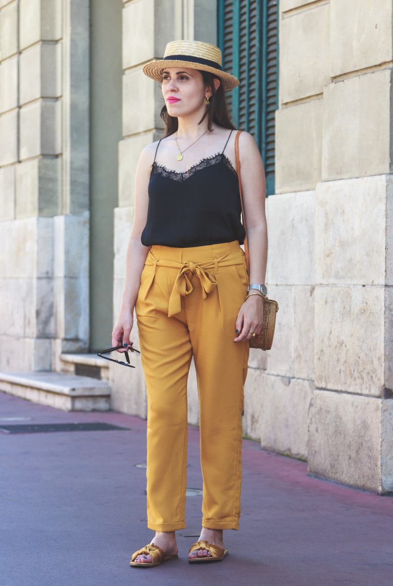 Le Fashionaire 5 essentials to holidays at Côte D' Azur silk lace black stradivarius top dark yellow lefties paperbag trousers dark yellow satin bow zara slides straw rattan round handmade bag 8155 EN 805x1202