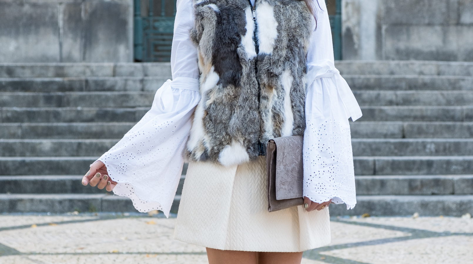 Le Fashionaire How to wear the fur vest in a romantic way fur brown white winter vest white bell sleeves swiss embroidered zara blouse white wool mango gold buttons skirt leather grey floral sfera clutch 2490F EN
