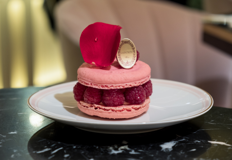 Le Fashionaire Ladurée in Lisbon: the tea room you need to know macarons pink orange brown chocolate passionfruit rose petals black marble chic table ispahan cake pink macaron raspberry rose petal 5259 EN 805x555