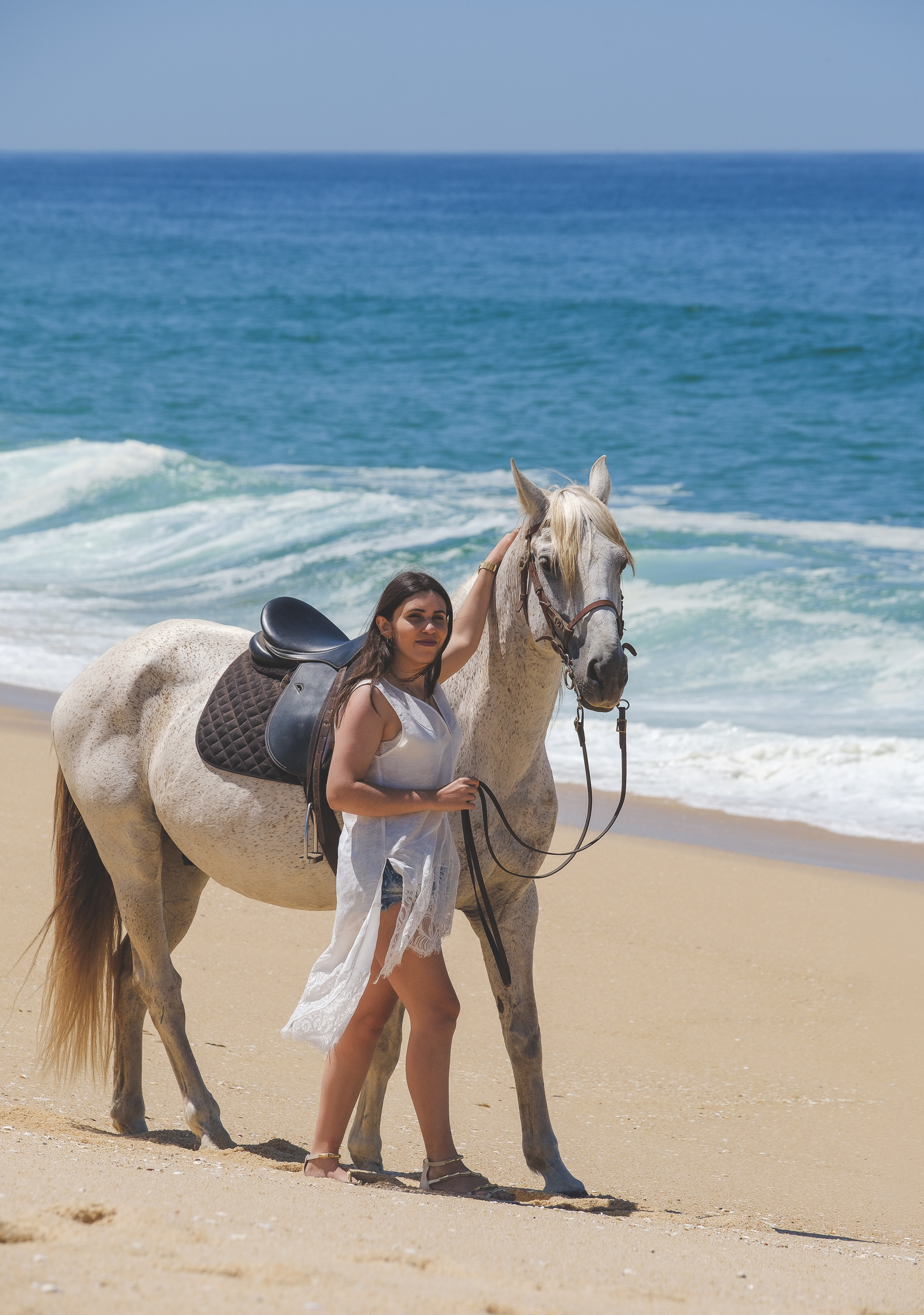 Le Fashionaire white horse ulisses white zara lace silk linen top denim shorts gold nude sandals santa lolla beach sand sun sea blue 4194 EN white horse ulisses white zara lace silk linen top denim shorts gold nude sandals santa lolla beach sand sun sea blue 4194 EN