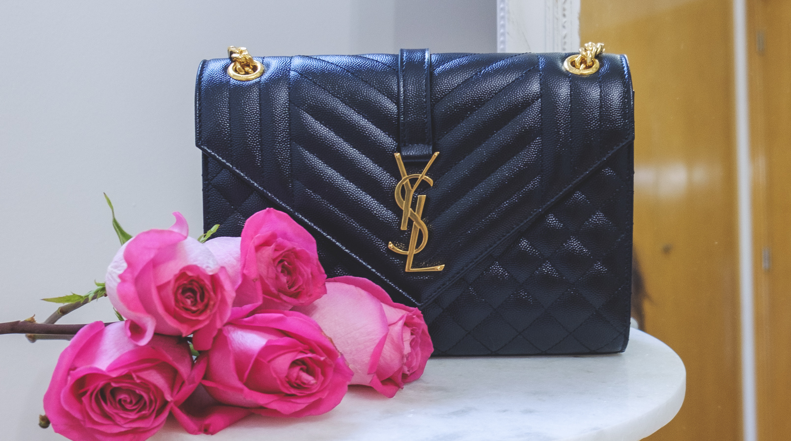 Le Fashionaire Is it worth it buying a Saint Laurent bag? ysl saint laurent black gold chain hardware luxury bag closet flowers roses bouquet 4372F EN