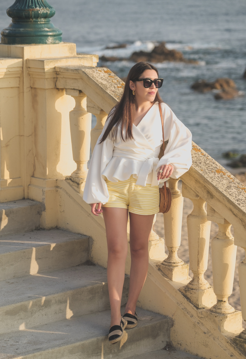 Le Fashionaire The perfect shirt to wear until Fall white shein shirt white yellow stripes zara shorts celine sunglasses black leather stripes zara espadrilles rattan round bag 1664 EN 805x1174