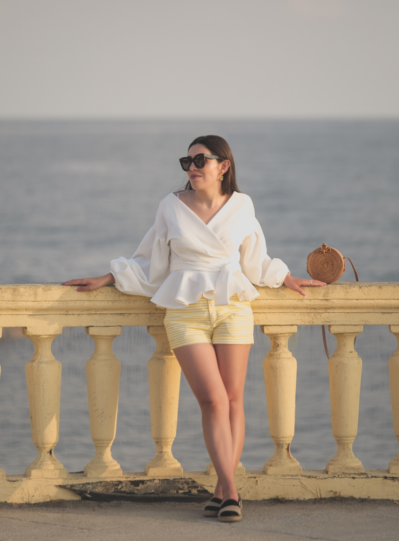 Le Fashionaire The perfect shirt to wear until Fall white shein shirt white yellow stripes zara shorts celine sunglasses black leather stripes zara espadrilles rattan round bag 1687 EN 805x1092